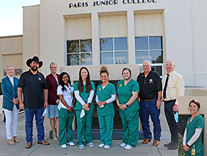 Roan Oak officials with students photo