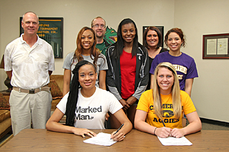 Volleyball players signing photo